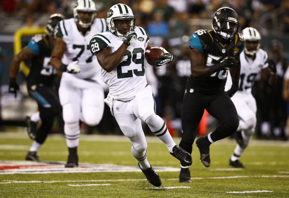 EAST RUTHERFORD, NJ - AUGUST 17:   Bilal Powell #29 of the New York Jets runs the ball against the Jacksonville Jaguars during their preseason game at MetLife Stadium on August 17, 2013 in East Rutherford, New Jersey.  (Photo by Jeff Zelevansky/Getty Images)