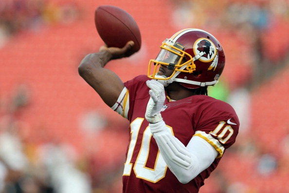 LANDOVER, MD - AUGUST 19: Quarterback Robert Griffin III #10 of the Washington Redskins warms up before the start of a preseason game against the Pittsburgh Steelers at FedExField on August 19, 2013 in Landover, Maryland.  (Photo by Rob Carr/Getty Images)