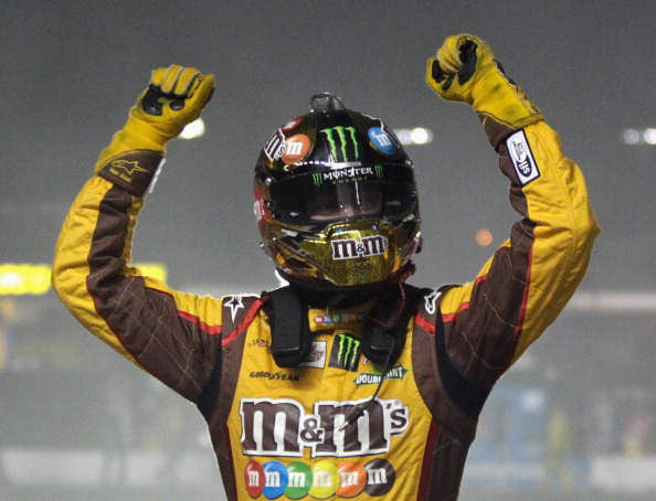 HAMPTON, GA - SEPTEMBER 01:  Kyle Busch, driver of the #18 M&M's Toyota, celebrates after winning the NASCAR Sprint Cup Series AdvoCare 500 at Atlanta Motor Speedway on September 1, 2013 in Hampton, Georgia.  (Photo by Matt Sullivan/Getty Images)