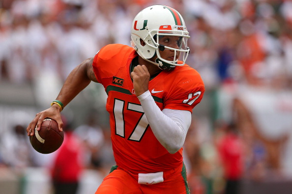 MIAMI GARDENS, FL - SEPTEMBER 07:  Stephen Morris #17 of the Miami Hurricanes passes during a game against the Florida Gators at Sun Life Stadium on September 7, 2013 in Miami Gardens, Florida.  (Photo by Mike Ehrmann/Getty Images)