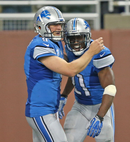 DETROIT, MI - SEPTEMBER 08: Reggie Bush #21 of the Detroit Lions celebrates with Matthew Stafford #9 after running  77 yards for a third quarter touchdown during the game against the Minnesota Vikings at Ford Field on September 8, 2013 in Detroit, Michigan.  (Photo by Leon Halip/Getty Images)