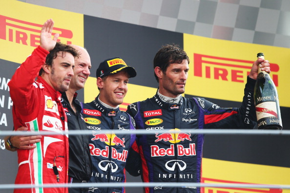 MONZA, ITALY - SEPTEMBER 08:  Race winner Sebastian Vettel (2nd right) of Germany and Infiniti Red Bull Racing, second placed Fernando Alonso (left) of Spain and Ferrari, third placed Mark Webber (right) of Australia and Infiniti Red Bull Racing and Infiniti Red Bull Racing Chief Technical Officer Adrian Newey (2nd left) celebrate on the podium following the Italian Formula One Grand Prix at Autodromo di Monza on September 8, 2013 in Monza, Italy.  (Photo by Clive Mason/Getty Images)