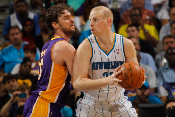 NEW ORLEANS, LA - MARCH 14:  Chris Kaman #35 of the New Orleans Hornets looks to drive the ball around Pau Gasol #16 of the Los Angeles Lakers at the New Orleans Arena on March 14, 2012 in New Orleans, Louisiana.  NOTE TO USER: User expressly acknowledges and agrees that, by downloading and or using this photograph, User is consenting to the terms and conditions of the Getty Images License Agreement.  (Photo by Chris Graythen/Getty Images)