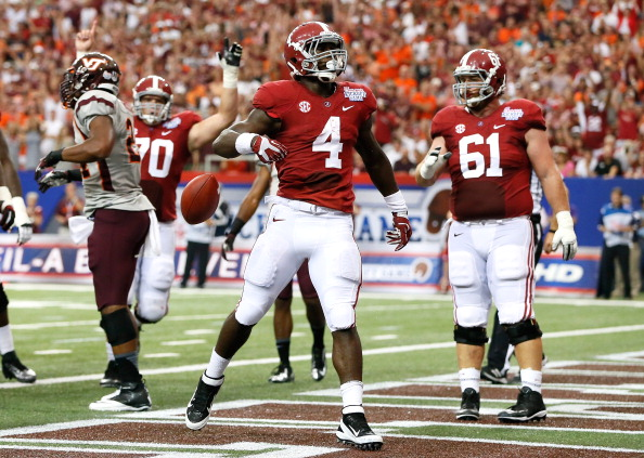 ATLANTA, GA - AUGUST 31:  T.J. Yeldon #4 of the Alabama Crimson Tide reacts after scoring a touchdown against the Virginia Tech Hokies at Georgia Dome on August 31, 2013 in Atlanta, Georgia.  (Photo by Kevin C. Cox/Getty Images)