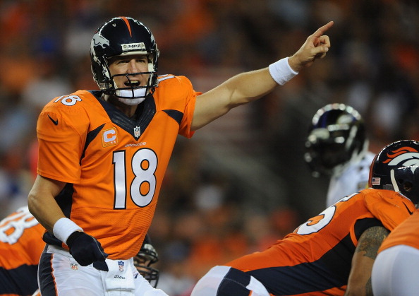 DENVER, CO - SEPTEMBER 5: Peyton Manning #18 of the Denver Broncos calls out to his teammates behind center against the Baltimore Ravens in the first half during the game at Sports Authority Field at Mile High on September 5, 2013 in Denver Colorado. (Photo by Dustin Bradford/Getty Images)