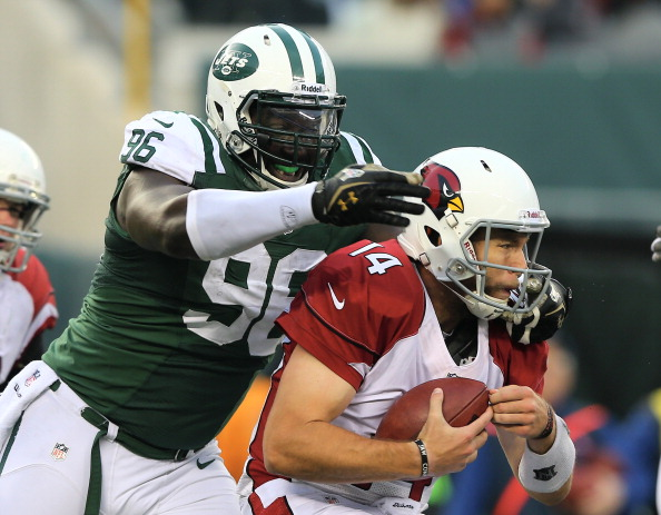 EAST RUTHERFORD, NJ - DECEMBER 02:  Ryan Lindley #14 of the Arizona Cardinals is sacked by  Muhammad Wilkerson #96 of the New York Jets on December 2, 2012 at MetLife Stadium in East Rutherford, New Jersey. The New York Jets defeated the Arizona Cardinals 7-6.  (Photo by Elsa/Getty Images)