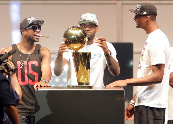MIAMI, FL - JUNE 24: Dwyane Wade, LeBron James and Chris Bosh of the Miami Heat celebrates the NBA Championship victory rally at the AmericanAirlines Arena on June 24, 2013 in Miami, Florida. The Miami Heat defeated the San Antonio Spurs in the NBA Finals.  (Photo by Alexander Tamargo/Getty Images)