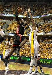 May 24, 2012; Indianapolis, IN, USA; Miami Heat forward LeBron James (6) goes up for a shot in the lane against Indiana Pacers center Roy Hibbert (55) during the first half in game six of the Eastern Conference semifinals of the 2012 NBA playoffs at Bankers Life Fieldhouse.  Mandatory Credit: Brian Spurlock-USA TODAY Sports