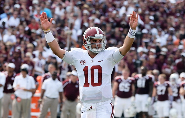 COLLEGE STATION, TX - SEPTEMBER 14:  AJ McCarron #10 of the Alabama Crimson Tide celebrates a second quarter touchdown during the game against the Texas A&M Aggies at Kyle Field on September 14, 2013 in College Station, Texas.  (Photo by Scott Halleran/Getty Images)