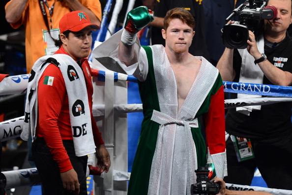 LAS VEGAS, NV - SEPTEMBER 14:  Canelo Alvarez in the ring before he takes on Floyd Mayweather Jr. in their WBC/WBA 154-pound title fight at the MGM Grand Garden Arena on September 14, 2013 in Las Vegas, Nevada.  (Photo by Ethan Miller/Getty Images)
