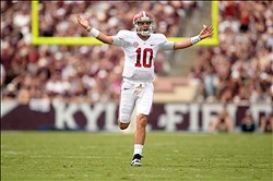 Sep 14, 2013; College Station, TX, USA; Alabama Crimson Tide quarterback A.J. McCarron (10) celebrates throwing a touchdown against the Texas A&M Aggies during the first half at Kyle Field. Mandatory Credit: Thomas Campbell-USA TODAY Sports