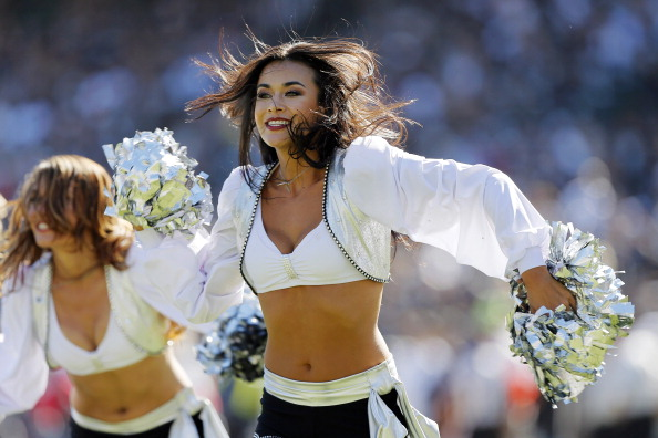 OAKLAND, CA - SEPTEMBER 15:  An Oakland Raiders cheerleader dances during a timeout against the Jacksonville Jaguars on September 15, 2013 at O.co Coliseum in Oakland, California.  The Raiders won 19-9. (Photo by Brian Bahr/Getty Images)
