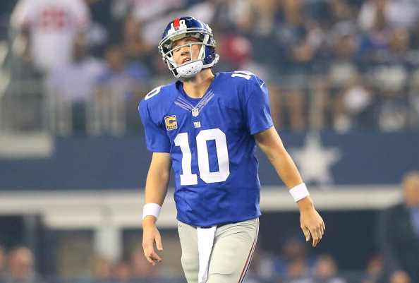 ARLINGTON, TX - SEPTEMBER 08:  Quarterback Eli Manning #10 of the New York Giants reacts in the first quarter against the Dallas Cowboys in the first half on September 8, 2013 at AT&T Stadium in Arlington, Texas.  (Photo by Ronald Martinez/Getty Images)