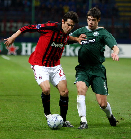 MILAN, ITALY - DECEMBER 04:  Kaka of Milan holds off a challenge from Darren O'Dea of Celtic during the UEFA Champions League Group D match between AC Milan and Celtic at the San Siro stadium on December 4, 2007 in Milan, Italy.  (Photo by Mike Hewitt/Getty Images)