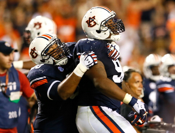 AUBURN, AL - SEPTEMBER 14:  Gabe Wright #90 and Angelo Blackson #98 of the Auburn Tigers celebrate after their 24-20 win over the Mississippi State Bulldogs at Jordan-Hare Stadium on September 14, 2013 in Auburn, Alabama.  (Photo by Kevin C. Cox/Getty Images)