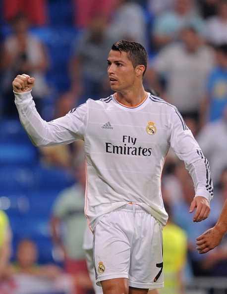 MADRID, SPAIN - SEPTEMBER 22:  Cristiano Ronaldo of Real Madrid celebrates after scoring during the La Liga match between Real Madrid and Getafe  at Bernabeu stadium on September 22, 2013 in Madrid, Spain.  (Photo by Denis Doyle/Getty Images)