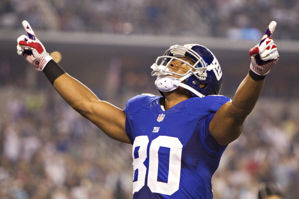 ARLINGTON, TX - SEPTEMBER 8:  Victor Cruz #80 of the New York Giants celebrates after scoring a touchdown against the Dallas Cowboys at AT&T Stadium on September 8, 2013 in Arlington, Texas.  The Cowboys defeated the Giants 31-36.  (Photo by Wesley Hitt/Getty Images)