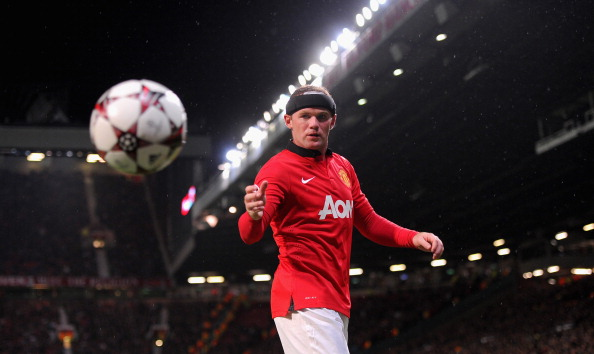 MANCHESTER, ENGLAND - SEPTEMBER 17:  Wayne Rooney of Manchester United retrieves the ball during the UEFA Champions League Group A match between Manchester United and Bayer Leverkusen at Old Trafford on September 17, 2013 in Manchester, England.  (Photo by Michael Regan/Getty Images)