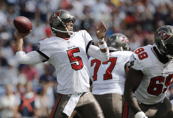 FOXBORO, MA - SEPTEMBER 22: Josh Freeman #5 of the Tampa Bay Buccaneers drops back to pass during the second half of their 23-3 loss to the New England Patriots at Gillette Stadium on September 22, 2013 in Foxboro, Massachusetts.  (Photo by Winslow Townson/Getty Images)