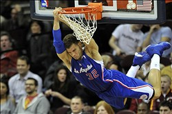 Mar 1, 2013; Cleveland, OH, USA; Los Angeles Clippers power forward Blake Griffin (32) hangs on the rim after a dunk in the fourth quarter against the Cleveland Cavaliers at Quicken Loans Arena. Mandatory Credit: David Richard-USA TODAY Sports