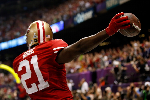 NEW ORLEANS, LA - FEBRUARY 03:  Frank Gore #21 of the San Francisco 49ers celebrates after scoring a touchdown in the third quarter against the Baltimore Ravens during Super Bowl XLVII at the Mercedes-Benz Superdome on February 3, 2013 in New Orleans, Louisiana.  (Photo by Chris Graythen/Getty Images)