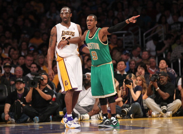 LOS ANGELES, CA - MARCH 11:  Rajon Rondo #9 of the Boston Celtics signals as he sets up against Kobe Bryant #24 of the Los Angeles Lakers at Staples Center on March 11, 2012 in Los Angeles, California.  The Lakers won 97-94.  NOTE TO USER: User expressly acknowledges and agrees that, by downloading and or using this photograph, User is consenting to the terms and conditions of the Getty Images License Agreement.  (Photo by Stephen Dunn/Getty Images)