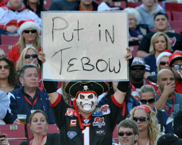 TAMPA, FL - DECEMBER 23: A fan of the Tampa Bay Buccaneers sets calls for a quarterback change against the St. Louis Rams December 23, 2012 at Raymond James Stadium in Tampa, Florida. (Photo by Al Messerschmidt/Getty Images)