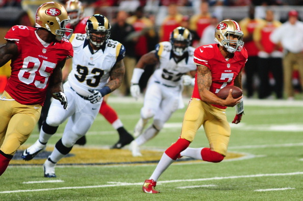 ST. LOUIS, MO - SEPTEMBER 26: Colin Kaepernick #7 of the San Francisco 49ers rushes the ball against the St. Louis Rams at the Edward Jones Dome on September 26, 2013 in St. Louis, Missouri.  (Photo by Michael Thomas/Getty Images)