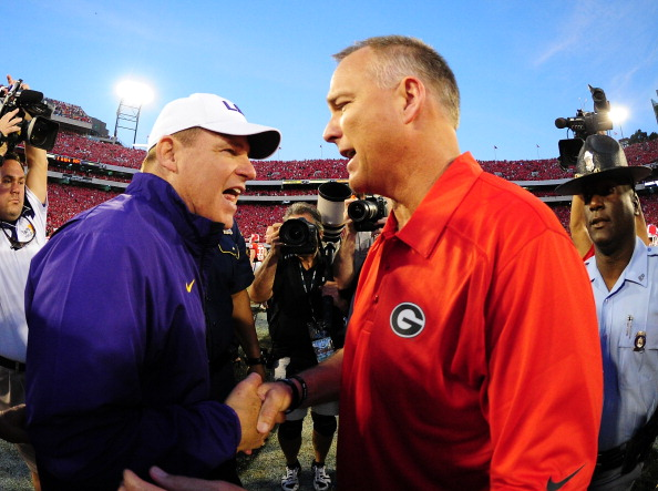 ATHENS, GA - SEPTEMBER 28: Head Coach Mark Richt (R) of the Georgia Bulldogs is congratulated by Head Coach Les Miles of the LSU Tigers after the game at Sanford Stadium on September 28, 2013 in Athens, Georgia. (Photo by Scott Cunningham/Getty Images)
