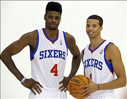 Sep 27, 2013; Philadelphia, PA, USA;  Philadelphia 76ers center Nerlens Noel (4) and point guard Michael Carter-Williams (1) during a media day photo shoot at Philadelphia College of Osteopathic Medicine. Mandatory Credit: Eric Hartline-USA TODAY Sports