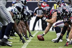Sep 29, 2013; Houston, TX, USA; Houston Texans center Chris Myers (55) snaps the ball during the second quarter against the Seattle Seahawks at Reliant Stadium. Mandatory Credit: Troy Taormina-USA TODAY Sports
