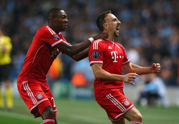 MANCHESTER, ENGLAND - OCTOBER 02:  Franck Ribery (R) of Muenchen celebrates scoring the opening goal with David Alaba of Muenchen during the UEFA Champions League Group D match between Manchester City and FC Bayern Muenchen at Etihad Stadium on October 2, 2013 in Manchester, England.  (Photo by Julian Finney/Getty Images)