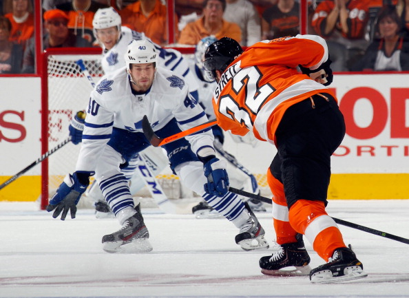 PHILADELPHIA, PA - OCTOBER 02: Troy Bodie #40 of the Toronto Maple Leafs looks to block a first period shot by Mark Streit #32 of the Philadelphia Flyers at the Wells Fargo Center on October 2, 2013 in Philadelphia, Pennsylvania.  (Photo by Bruce Bennett/Getty Images)