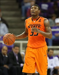 Feb 27, 2013; Fort Worth, TX, USA; Oklahoma State Cowboys guard Marcus Smart (33) during the game against TCU Horned Frogs at the Daniel-Meyer Coliseum. Oklahoma State Cowboys won 64-47. Mandatory Credit: Jim Cowsert-USA TODAY Sports