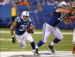 Aug 24, 2013; Indianapolis, IN, USA; Indianapolis Colts running back Donald Brown (31) runs with the ball against the Cleveland Browns at Lucas Oil Stadium. Mandatory Credit: Brian Spurlock-USA TODAY Sports