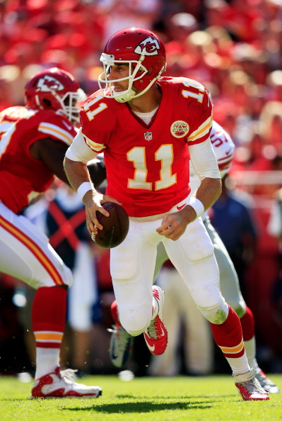 KANSAS CITY, MO - SEPTEMBER 29:  Quarterback Alex Smith #11 of the Kansas City Chiefs scrambles during the game against the New York Giants at Arrowhead Stadium on September 29, 2013 in Kansas City, Missouri.  (Photo by Jamie Squire/Getty Images)