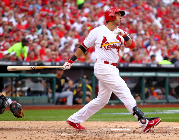 ST LOUIS, MO - OCTOBER 03:  Carlos Beltran #3 of the St. Louis Cardinals hits a three-run home run in the third inning against the Pittsburgh Pirates during Game One of the National League Division Series at Busch Stadium on October 3, 2013 in St Louis, Missouri.  (Photo by Dilip Vishwanat/Getty Images)