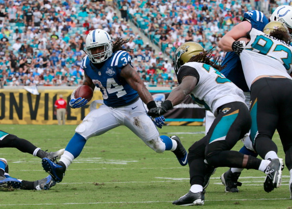 JACKSONVILLE, FL - SEPTEMBER 29:  Trent Richardson #34 of the Indianapolis Colts runs for yardage during the game against the Jacksonville Jaguars at EverBank Field on September 29, 2013 in Jacksonville, Florida.  (Photo by Sam Greenwood/Getty Images)