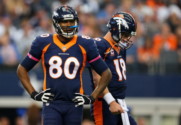 ARLINGTON, TX - OCTOBER 06:  (L-R)  Julius Thomas #80 of the Denver Broncos and  Peyton Manning #18 on the field in between downs against the Dallas Cowboys in the first quarter at AT&T Stadium on October 6, 2013 in Arlington, Texas.  (Photo by Ronald Martinez/Getty Images)