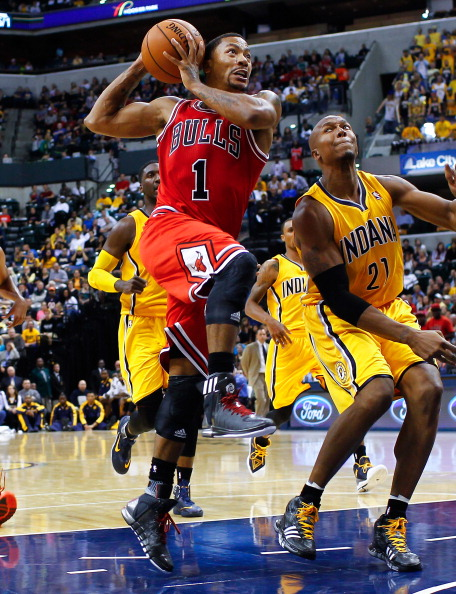 INDIANAPOLIS, IN - OCTOBER 05: Derrick Rose #1 of the Chicago Bulls takes the ball to the hoop against David West #21 of the Indiana Pacers on October 5, 2013 at Bankers Life Fieldhouse in Indianapolis, Indiana. Chicago defeated Indiana 82-76. NOTE TO USER: User expressly acknowledges and agrees that, by downloading and or using this Photograph, user is consenting to the terms and conditions of the Getty Images License Agreement. (Photo by Michael Hickey/Getty Images)