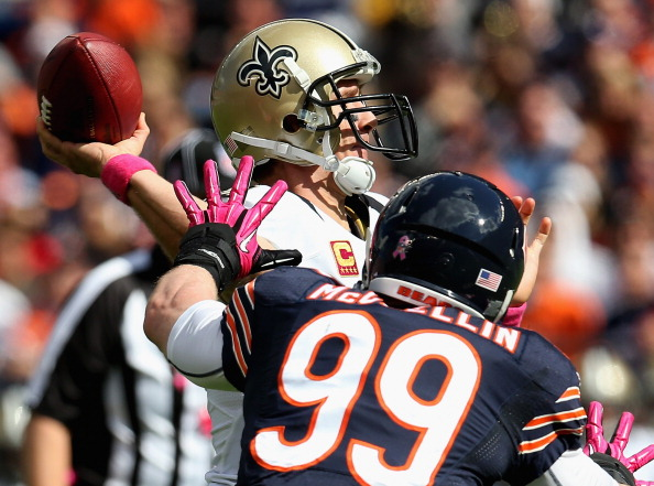 CHICAGO, IL - OCTOBER 06:  Drew Brees #9 of the New Orleans Saints passes under pressure from Shea McClellin #99 of the Chicago Bears at Soldier Field on October 6, 2013 in Chicago, Illinois. The Saints defeated the Bears 26-18.  (Photo by Jonathan Daniel/Getty Images)