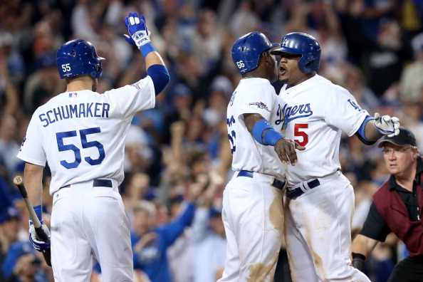 LOS ANGELES, CA - OCTOBER 07:  Juan Uribe #5 of the Los Angeles Dodgers celebrates with Hanley Ramirez #13 and Skip Schumaker #55 after Uribe hits a two-run home run in the eighth inning against the Atlanta Braves in Game Four of the National League Division Series at Dodger Stadium on October 7, 2013 in Los Angeles, California.  (Photo by Stephen Dunn/Getty Images)