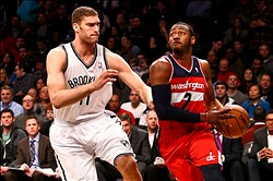 Mar. 8, 2013; Brooklyn, NY, USA; Washington Wizards point guard John Wall (2) goes up for a shot as Brooklyn Nets center Brook Lopez (11) defends during the first half at Barclays Center. Nets won 95-78. Mandatory Credit: Debby Wong-USA TODAY Sports