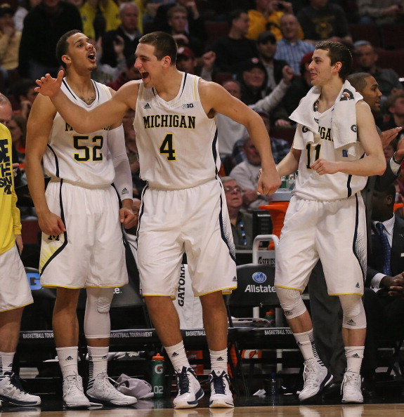 CHICAGO, IL - MARCH 14: (L-R) Jordan Morgan #52, Mitch McGary #4 and Nik Stauskas #11 of the Michigan Wolverines celebrate a win over the Penn State Nittany Lions during a first round game of the Big Ten Basketball Tournament at the United Center on March 14, 2013 in Chicago, Illinois. Michigan defeated Penn State 83-66.  (Photo by Jonathan Daniel/Getty Images)