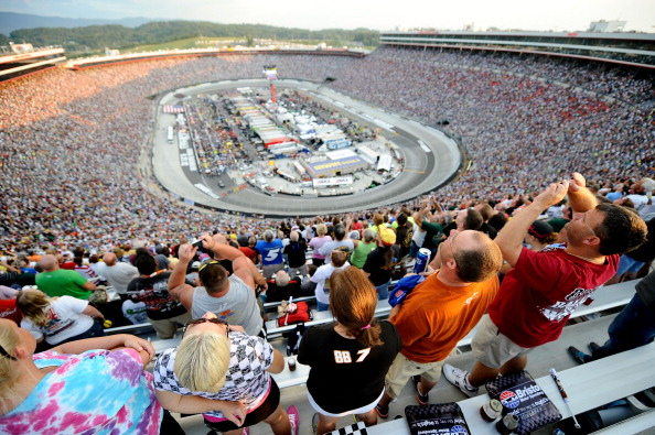 BRISTOL, TN - AUGUST 25:  Fans Stand for the national anthem prior to the NASCAR Sprint Cup Series IRWIN Tools Night Race at Bristol Motor Speedway on August 25, 2012 in Bristol, Tennessee.  (Photo by Jared C. Tilton/Getty Images)