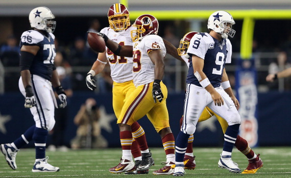 ARLINGTON, TX - NOVEMBER 22:   Tony Romo #9 of the Dallas Cowboys walks off the field after throwing a pass reception to London Fletcher #59 of the Washington Redskins during the Thanksgiving Day game at Cowboys Stadium on November 22, 2012 in Arlington, Texas.  (Photo by Ronald Martinez/Getty Images)
