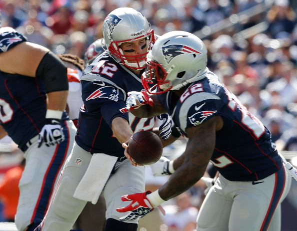 FOXBORO, MA - SEPTEMBER 22: Tom Brady #12 of the New England Patriots hands the ball to Stevan Ridley #22 in the first half at Gillette Stadium on September 22, 2013 in Foxboro, Massachusetts. (Photo by Jim Rogash/Getty Images)