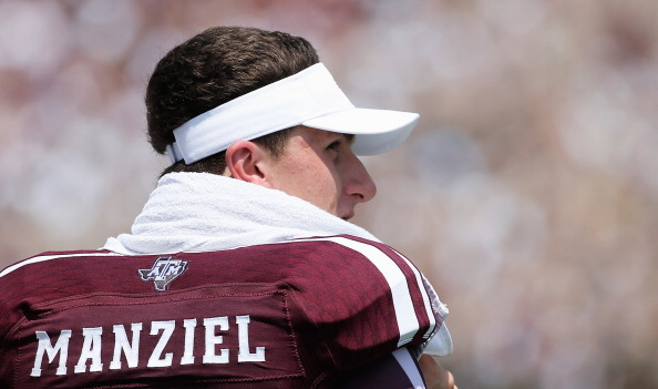COLLEGE STATION, TX - AUGUST 31:  Johnny Manziel #2 of the Texas A&M Aggies waits near the bench during the second quarter of the game against the Rice Owls at Kyle Field on August 31, 2013 in College Station, Texas.  (Photo by Scott Halleran/Getty Images)