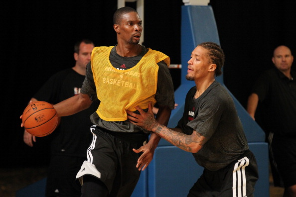 NASSAU, BAHAMAS - OCTOBER 4:  Chris Bosh #1 and Michael Beasley #8 of the Miami Heat participate in Training Camp on October 4, 2013 at Atlantis Resort in Nassau, Bahamas. NOTE TO USER: User expressly acknowledges and agrees that, by downloading and or using this photograph, User is consenting to the terms and conditions of the Getty Images License Agreement. Mandatory Copyright Notice: Copyright 2013 NBAE (Photo by Issac Baldizon/NBAE via Getty Images)