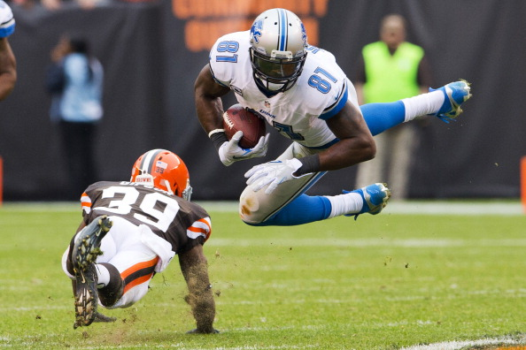 CLEVELAND, OH - OCTOBER 13: Free safety Tashaun Gipson #39 of the Cleveland Browns tackles wide receiver Calvin Johnson #81 of the Detroit Lions during the second half at FirstEnergy Stadium on October 13, 2013 in Cleveland, Ohio. The Lions defeated the Browns 31-17. (Photo by Jason Miller/Getty Images)